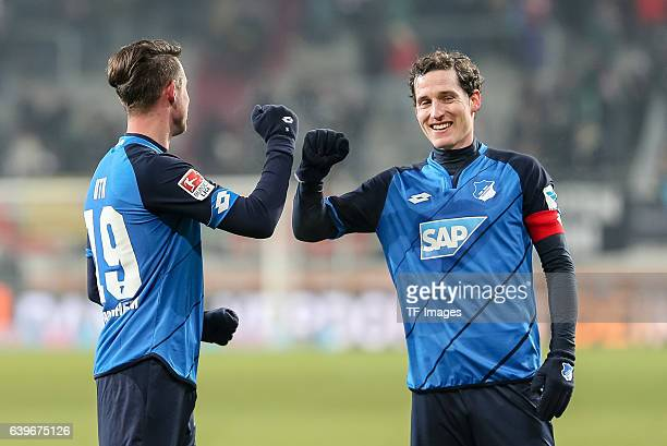 Mark Alexander Uth of 1899 Hoffenheim shakes hands with Sebastian Rudy of 1899 Hoffenheim during the Bundesliga match between FC Augsburg and TSG...