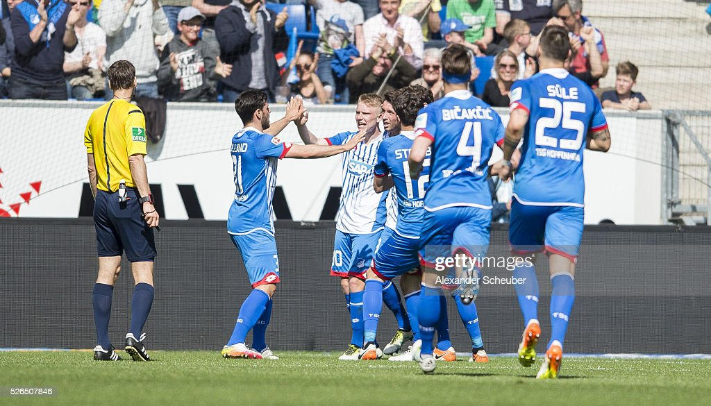 Mark Alexander Uth of Hoffenheim celebrates the first goal for his team with Philipp Ochs of Hoffenheim, Ermin Bicakcic of Hoffenheim and Kevin Volland of Hoffenheim during the first bundesliga match between 1899 Hoffenheim and FC Ingolstadt at Wirsol Rhein-Neckar-Arena on April 30, 2016 in Sinsheim, Germany.