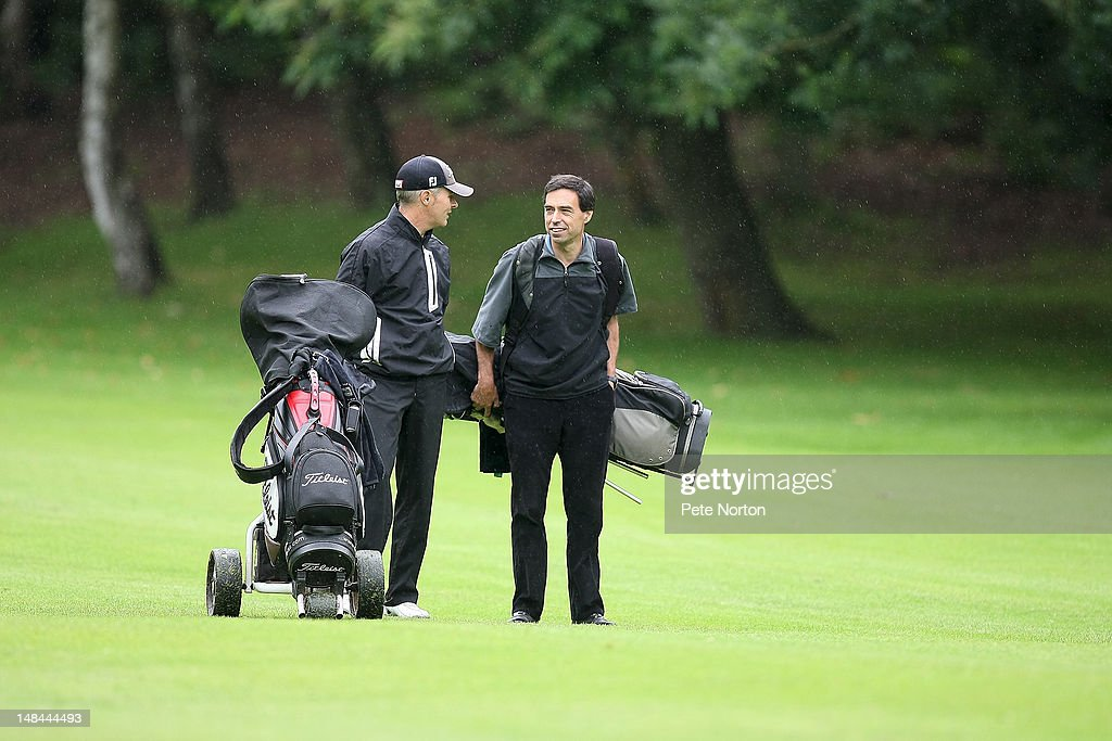 Mark Allen (l) and Adrian Mnn of Eaton Golf Club disciss a shot during the Virgin Atlantic PGA National Pro-Am Championship - Regional Final at King's Lynn Golf Club on July 16, 2012 in King's Lynn, England.
