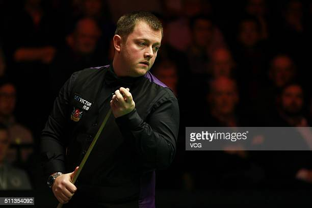 Mark Allen of England chalks his cue in the quarterfinal match against Michael White of Wales on day five of BetVictor Welsh Open 2016 at Motorpoint...