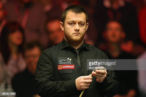 Mark Allen of Great Britain looks on during his quarterfinal match against Joe Perry on day six of the Dafabet Masters at Alexandra Palace on January...