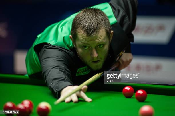 Mark Allen of North Ireland plays a shot during the first round match against Yan Bingtao of China on day one of 2017 Shanghai Masters at Shanghai...