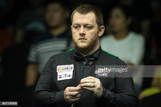Mark Allen of Northern Ireland chalks the cue during his semifinal match against Kyren Wilson of England on day six of the World Open 2017 at Yushan...