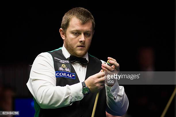 Mark Allen of Northern Ireland chalks the cue during the first round match against Mark Joyce of England on day two of Coral Northern Ireland Open...