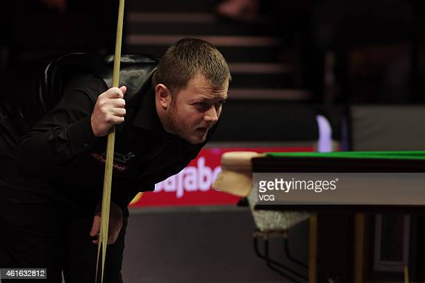 Mark Allen of Northern Ireland eyes the ball in his match against Joe Perry of England during day six of the 2015 Dafabet Masters at Alexandra Palace...
