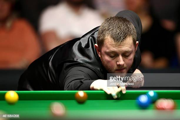 Mark Allen of Northern Ireland looks dejected after missing a pot during his semifinal match against Shaun Murphy of Great Britain on day seven of...