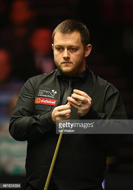 Mark Allen of Northern Ireland looks on during his first round match against John Higgins of Scotland on Day Four of the 2015 Dafabet Masters at...
