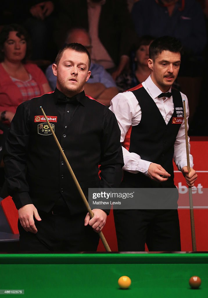Mark Allen of Northern Ireland looks on during his match against <a gi-track='captionPersonalityLinkClicked' href=/galleries/search?phrase=Michael+Holt&family=editorial&specificpeople=680689 ng-click='$event.stopPropagation()'>Michael Holt</a> of England during day four of the The Dafabet World Snooker Championship at Crucible Theatre on April 21, 2014 in Sheffield, England.
