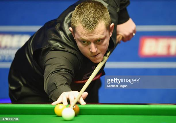 Mark Allen of Northern Ireland plays a shot against Barry Hawkins of England during day seven of the 2015 Betfred World Snooker Championship at...