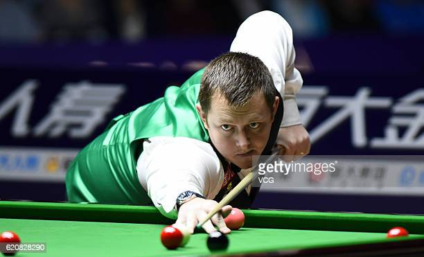 Mark Allen of Northern Ireland plays a shot against Mark Selby of England in the quarterfinals on Day three of the Evergrande China Championship at...