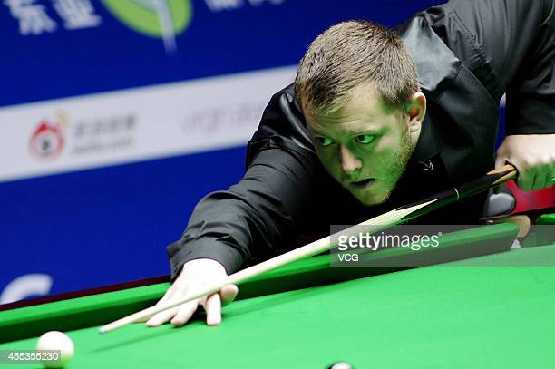 Mark Allen of Northern Ireland plays a shot against Mark Selby of England during day six of the World Snooker Bank of Communications OTO Shanghai...