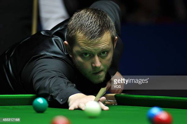 Mark Allen of Northern Ireland plays a shot against Michael White of Wales during day five of the World Snooker Bank of Communications OTO Shanghai...