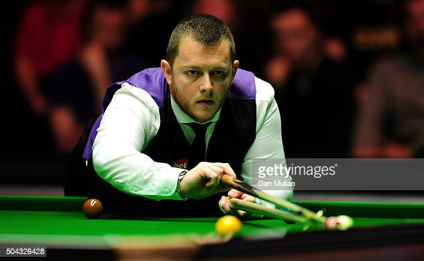 Mark Allen of Northern Ireland plays a shot against Shaun Murphy of England during Day One of the Dafabet Masters at Alexandra Palace on January 10...