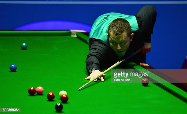 Mark Allen of Northern Ireland plays a shot during his first round match against Mitchell Mann of England on day 5 of the World Snooker Championship...