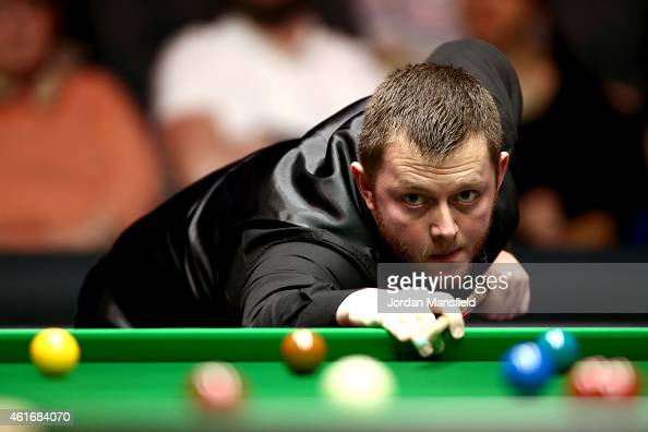 Mark Allen of Northern Ireland plays a shot during his semifinal match against Shaun Murphy of Great Britain on day seven of the 2015 Dafabet Masters...
