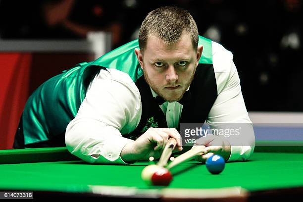 Mark Allen of Northern Ireland plays a shot during the first round match against Jamie CurtisBarrett of England on day two of the Coral English Open...