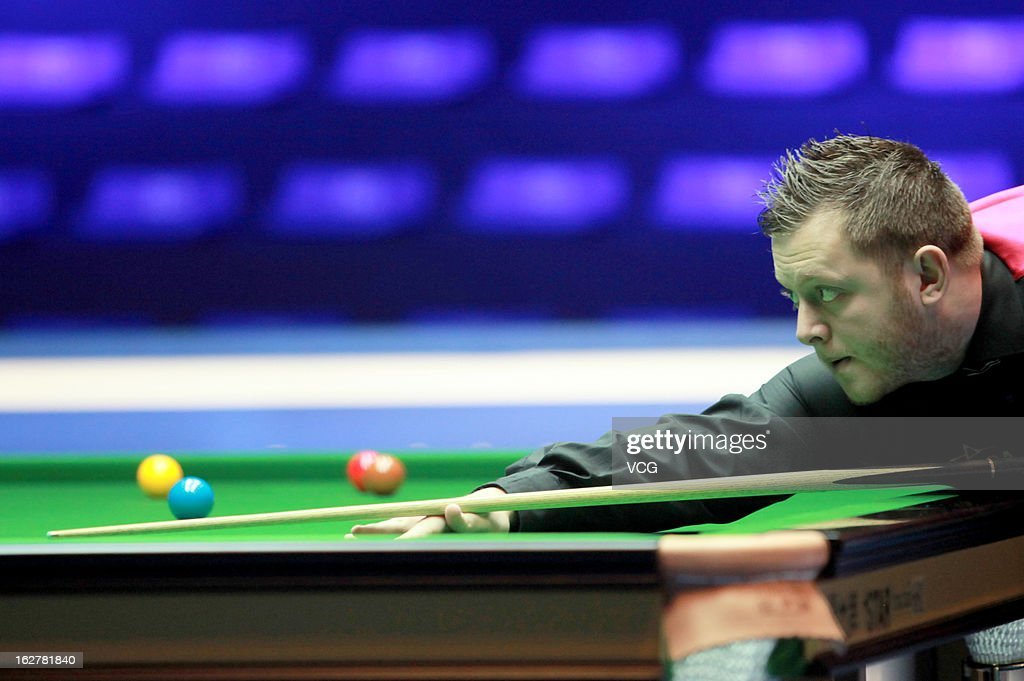Mark Allen of Northern Ireland plays a shot during the match against Ryan Day of Wales on day Two of the 2013 World Snooker Haikou Open at Haikou Convention & Exhibition Center on February 26, 2013 in Haikou, Hainan Province of China.