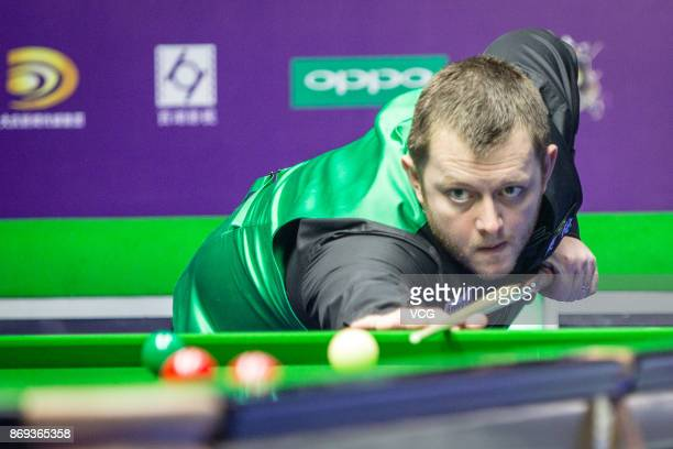 Mark Allen of Northern Ireland plays a shot during the quarterfinal match against Judd Trump of England on Day five of the 2017 Snooker International...