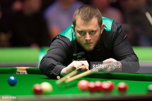 Mark Allen of Northern Ireland plays a shot during the third round match against Ryan Day of Wales in Session 7 on day 8 of Betway UK Championship...