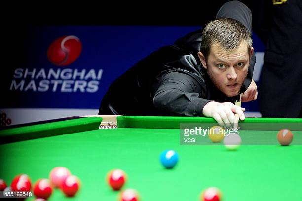 Mark Allen of Northern Ireland plays a shot in the match against Andrew Higginson of England during day three of the World Snooker Bank of...