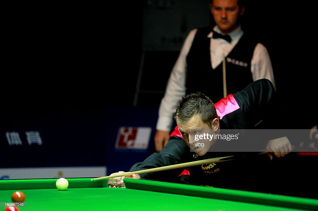 <a gi-track='captionPersonalityLinkClicked' href=/galleries/search?phrase=Mark+Allen+-+Snooker+Player&family=editorial&specificpeople=4502854 ng-click='$event.stopPropagation()'>Mark Allen</a> of Northern Ireland plays a shot in the match against Ryan Day of Wales on day three of the 2013 World Snooker Shanghai Master at Shanghai Grand Stage on September 18, 2013 in Shanghai, China.