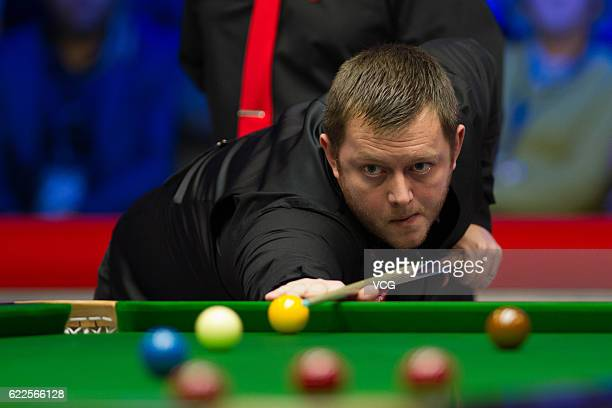 Mark Allen of Northern Ireland plays a shot in the semifinal match against Ronnie O'Sullivan of England on day five of Champion of Champions 2016 at...