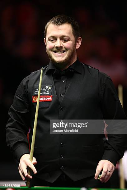 Mark Allen of Northern Ireland reacts after playing a shot during his semifinal match against Shaun Murphy of Great Britain on day seven of the 2015...