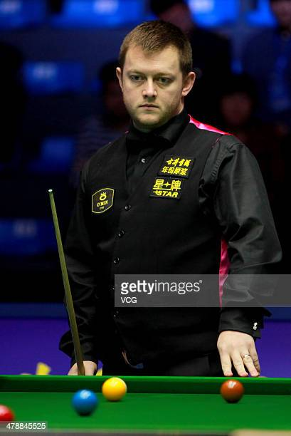 Mark Allen of Northern Ireland reacts against John Higgins of Scotland on day five of the 2014 Snooker Haikou World Open at Hainan International...