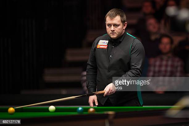 Mark Allen of Northern Ireland reacts during the quarterfinal match against Marco Fu of Chinese Hong Kong on day five of the Dafabet Masters at...