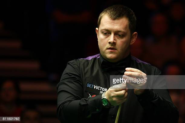 Mark Allen of Northern Ireland reacts in the semifinal match against Neil Robertson of Australia on day six of BetVictor Welsh Open 2016 at...
