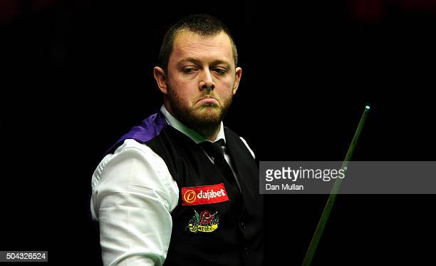 Mark Allen of Northern Ireland reacts whilst playing against Shaun Murphy of England during Day One of the Dafabet Masters at Alexandra Palace on...
