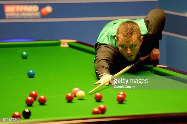 Mark Allen plays a shot against Mitchell Mann during their first round match of the World Snooker Championship at Crucible Theatre on April 19 2016...