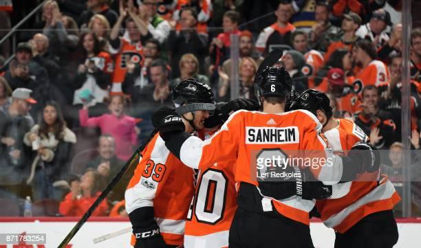 Mark Alt Jordan Weal Travis Sanheim and Jori Lehtera of the Philadelphia Flyers celebrate a third period goal against the Colorado Avalanche on...