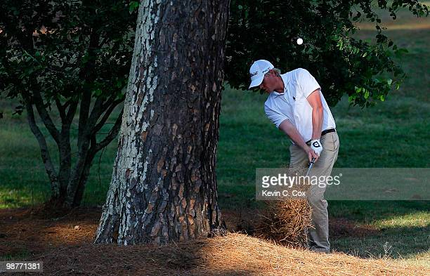 Mark Anderson chips into the 18th fairway from behind a tree during the second round of the 2010 Stadion Athens Classic at the University of Georgia...