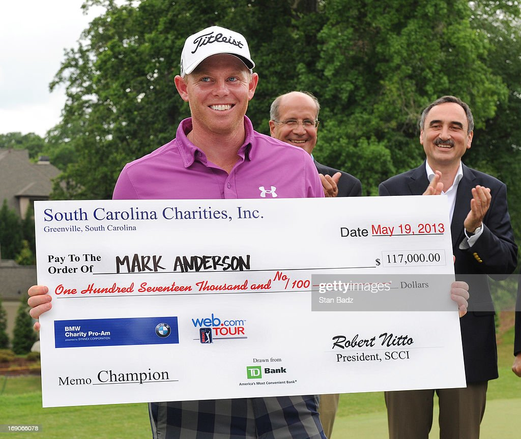 Mark Anderson poses with the winner's check after the final round of the BMW Charity Pro-Am Presented by SYNNEX Corporation at the Thornblade Club on May 19, 2013 in Greer, South Carolina.