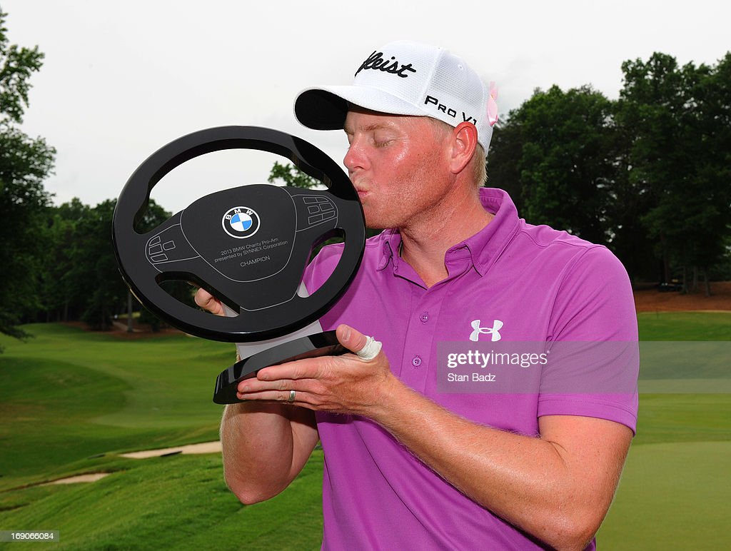 Mark Anderson poses with the winner's trophy after the final round of the BMW Charity Pro-Am Presented by SYNNEX Corporation at the Thornblade Club on May 19, 2013 in Greer, South Carolina.