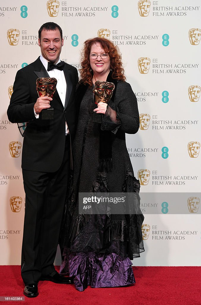 Mark Andrews (L) and Brenda Chapman pose with the award for best animated film for their work on 'Brave' during the annual BAFTA British Academy Film Awards at the Royal Opera House in London on February 10, 2013. AFP PHOTO/Carl COURT