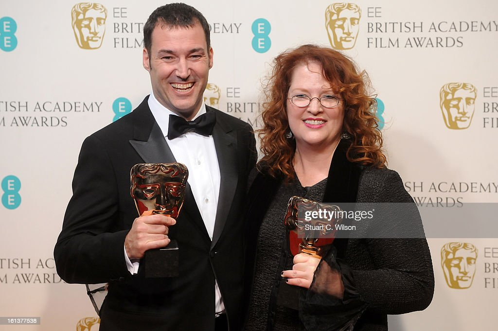 Mark Andrews (L) and Brenda Chapman, winners of the Animated Film film award for 'Brave', pose in the press room at the EE British Academy Film Awards at The Royal Opera House on February 10, 2013 in London, England.