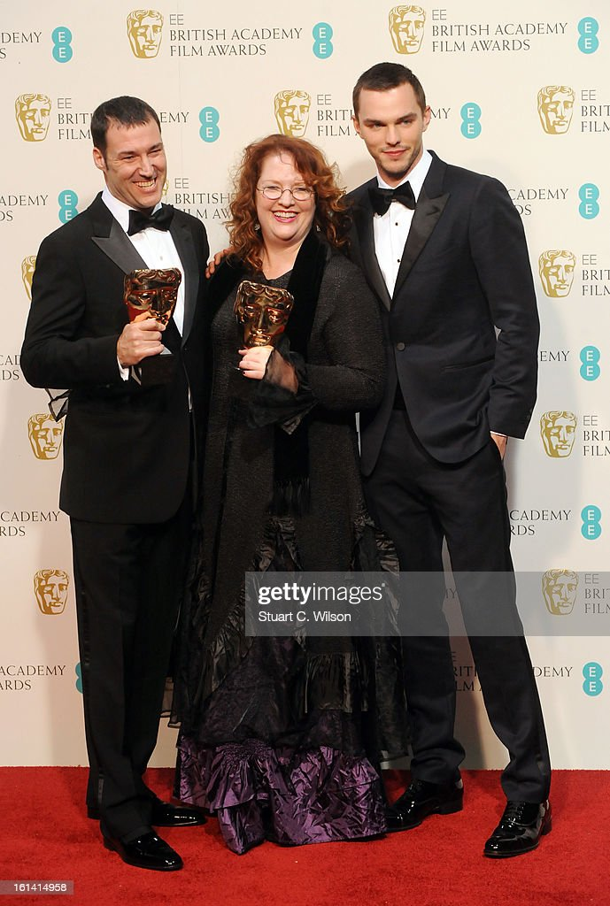 Mark Andrews (L) and Brenda Chapman (C), winners of the Animated Film film award for 'Brave', pose in the press room with presneter Nicholas Hoult (R) at the EE British Academy Film Awards at The Royal Opera House on February 10, 2013 in London, England.