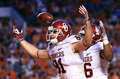 Mark Andrews of the Oklahoma Sooners celebrates scoring a touchdown in the second quarter against the Clemson Tigers during the 2015 Capital One...