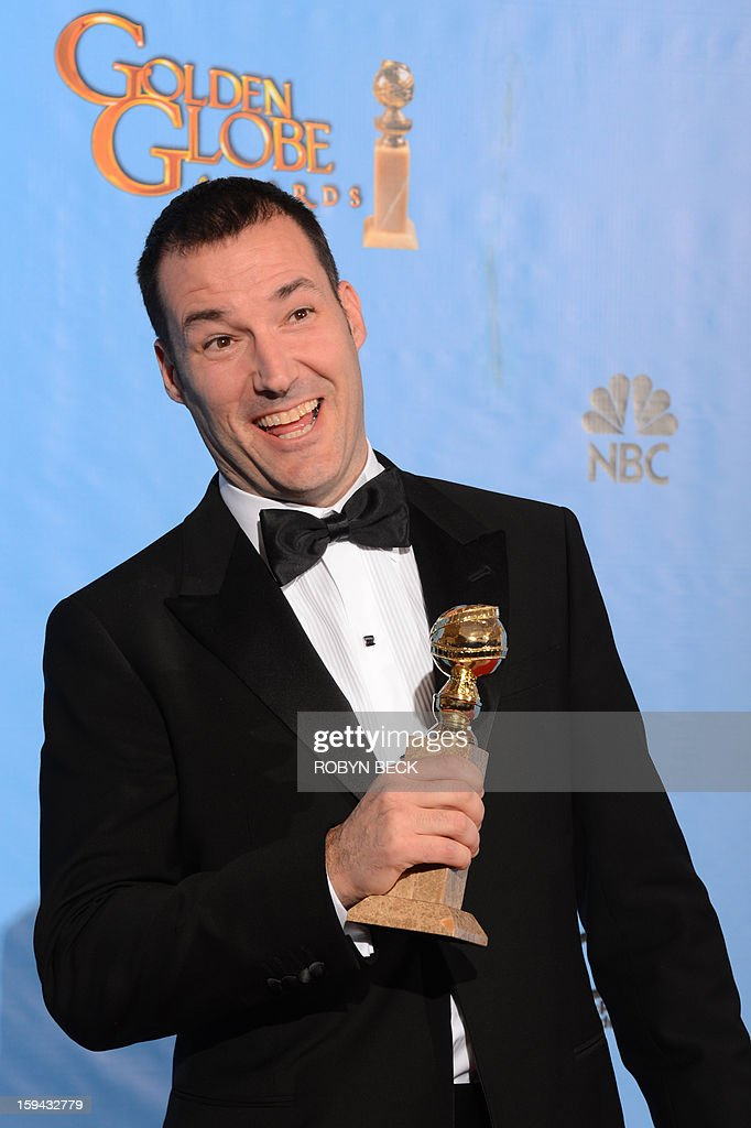 Mark Andrews poses in the press room with his Best animated feature film award for 'Brave' at the Golden Globes awards ceremony in Beverly Hills on January 13, 2013. AFP PHOTO/Robyn BECK