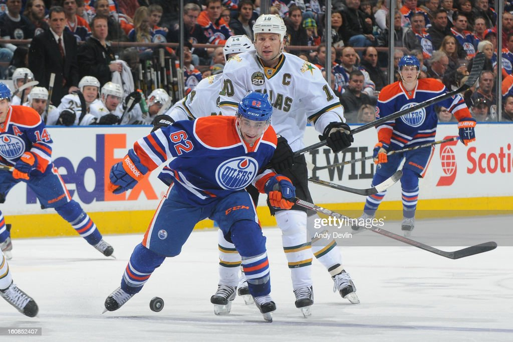 Mark Arcobello #62 of the Edmonton Oilers battles for position against <a gi-track='captionPersonalityLinkClicked' href=/galleries/search?phrase=Brenden+Morrow&family=editorial&specificpeople=202256 ng-click='$event.stopPropagation()'>Brenden Morrow</a> #10 of the Dallas Stars on February 6, 2013 at Rexall Place in Edmonton, Alberta, Canada.