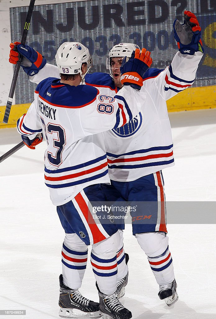 <a gi-track='captionPersonalityLinkClicked' href=/galleries/search?phrase=Mark+Arcobello&family=editorial&specificpeople=4459539 ng-click='$event.stopPropagation()'>Mark Arcobello</a> #26 of the Edmonton Oilers celebrates his overtime winning goal with teammate <a gi-track='captionPersonalityLinkClicked' href=/galleries/search?phrase=Ales+Hemsky&family=editorial&specificpeople=202828 ng-click='$event.stopPropagation()'>Ales Hemsky</a> #83 against the Florida Panthers at the BB&T Center on November 5, 2013 in Sunrise, Florida.