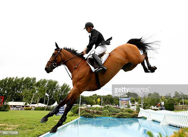 Mark Armstrong of Great Britain ridding Thesaura going over the water jump during the Longines King George V Gold Cup at the Longines International...