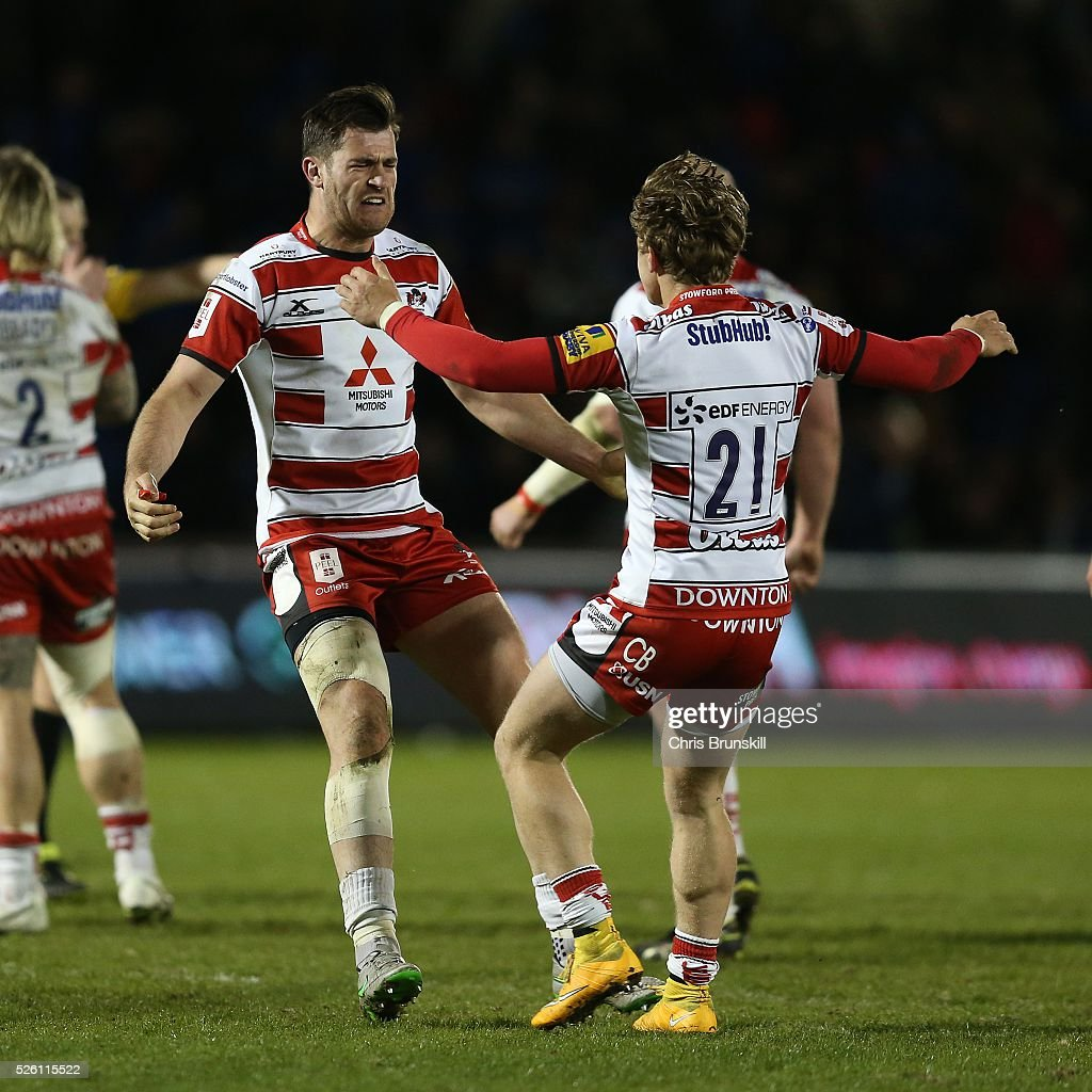 Mark Atkinson (L) of Gloucester Rugby celebrates at full-time with team-mate Callum Braley following the Aviva Premiership match between Sale Sharks and Gloucester Rugby at the AJ Bell Stadium on April 29, 2016 in Salford, England.