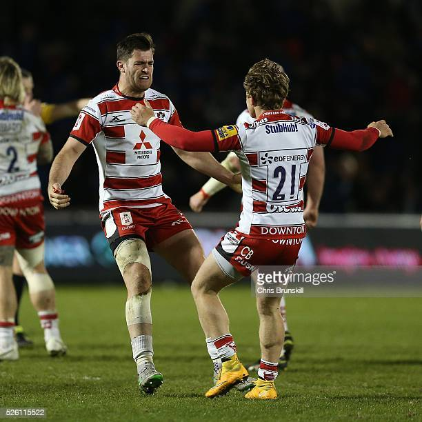 Mark Atkinson of Gloucester Rugby celebrates at fulltime with teammate Callum Braley following the Aviva Premiership match between Sale Sharks and...