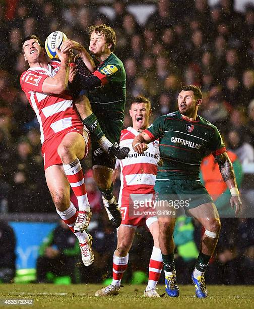 Mark Atkinson of Gloucester Rugby jumps for the ball with Matthew Tait of Leicester during the Aviva Premiership match between Leicester Tigers and...