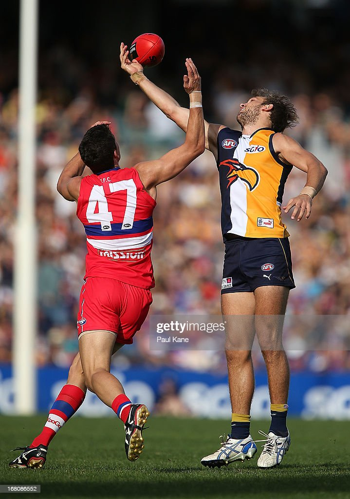 Mark Austin of the Bulldogs and Will Schofield of the Eagles contest for the ball during the round six AFL match between the West Coast Eagles and the Western Bulldogs at Patersons Stadium on May 5, 2013 in Perth, Australia.
