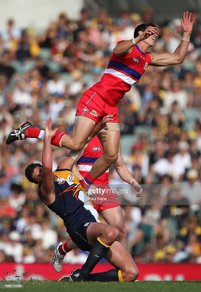Mark Austin of the Bulldogs collides with Dean Cox of the Eagles during the round six AFL match between the West Coast Eagles and the Western Bulldogs at Patersons Stadium on May 5, 2013 in Perth, Australia.