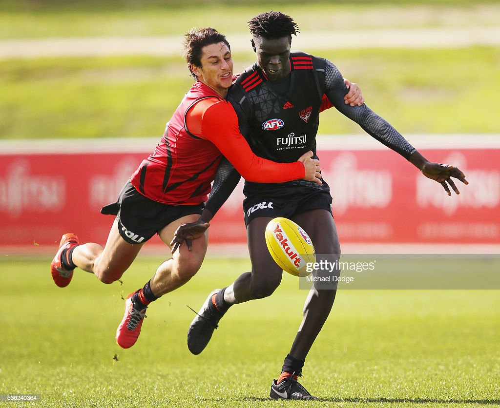 Mark Baguley of the Bombers tackles Gach Nyuon during an Essendon Bombers AFL training session at True Value Solar Centre on June 1, 2016 in Melbourne, Australia.
